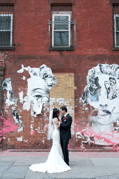 Georgia and Manny wedding photo with graffiti background.
